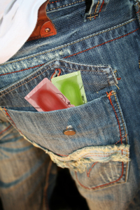 condoms waiting patiently in a mans denim pocket